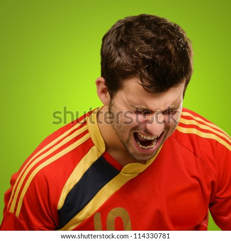 Portrait Of An Excited Player Isolated On Green Background
