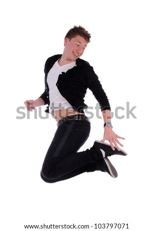 Portrait of an excited young man jumping in air against white background