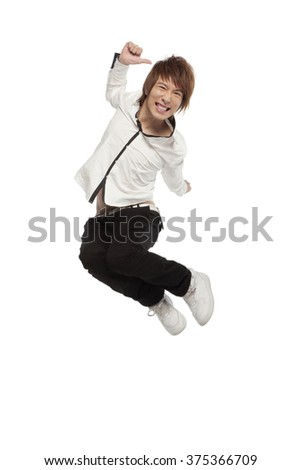 Portrait of an excited young man mid-air - stock photo