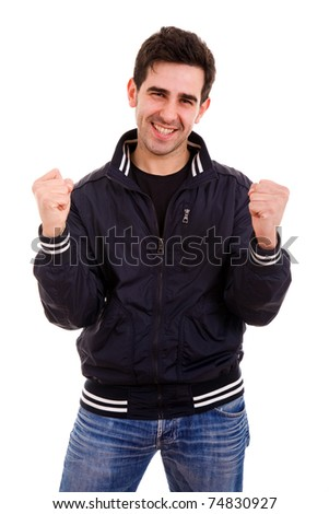 Portrait of an excited young man with hands raised in victory against white background - stock photo