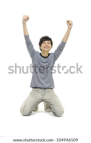 Portrait of an excited young man with hands raised in victory in floor - stock photo