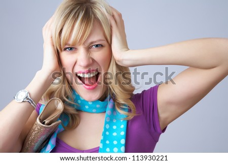 Portrait of an excited young woman against white background - stock photo