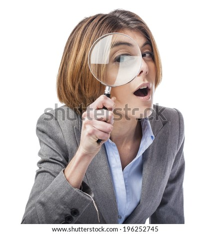 portrait of an executive young woman looking through a magnifying glass