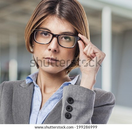 portrait of an executive young woman putting on her glasses
