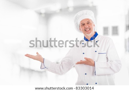 Portrait of an experienced chef presenting something
