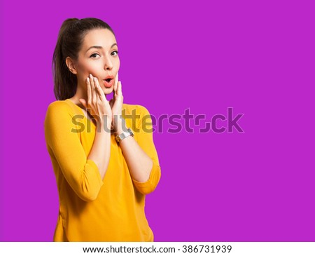 Portrait of an expressive brunette isolated on colorful background. - stock photo
