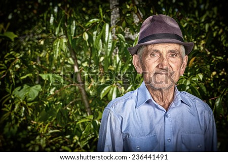Portrait of an expressive old farmer outdoor. - stock photo
