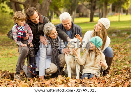 Portrait of an extended family on an autumns day - stock photo