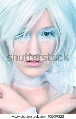 Portrait of an extravagant blonde model. Isolated over white background.