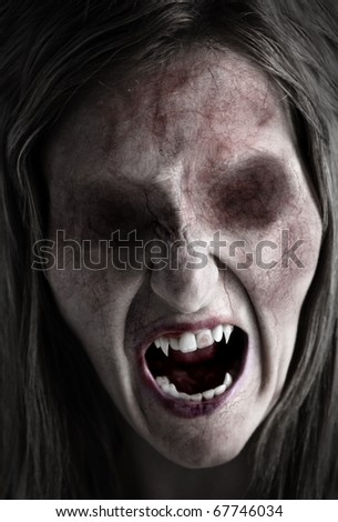 Portrait of an eyeless female ghoul or zombie - stock photo