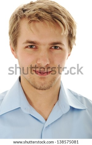 Portrait of an handsome blond man wearing a shirt looking at camera - stock photo
