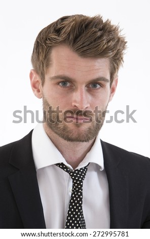Portrait of an handsome business man looking at camera - stock photo
