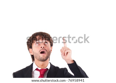 Portrait of an handsome businessman looking and pointing his finger up - stock photo