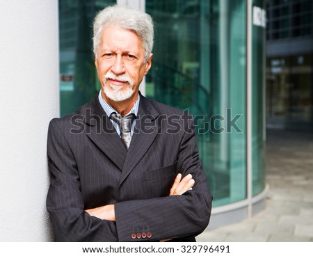 Portrait of an handsome businessman outdoor - stock photo