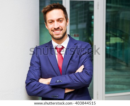 Portrait of an handsome businessman outdoor