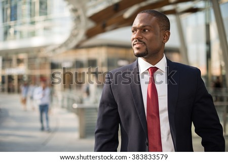 Portrait of an handsome businessman walking in a business environment - stock photo