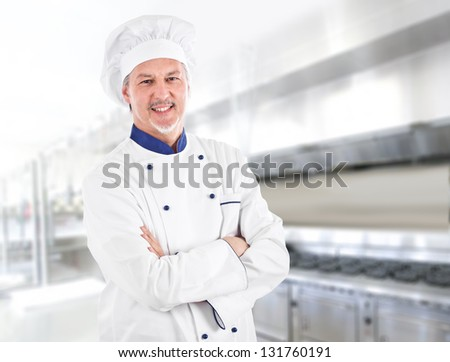 Portrait of an handsome chef at work