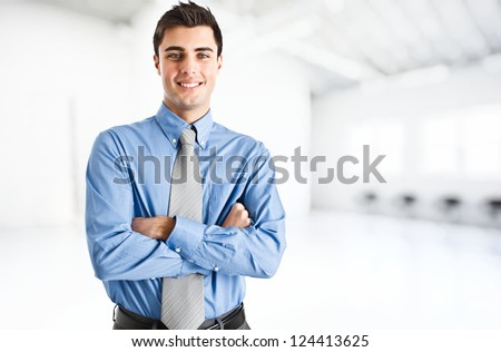 Portrait of an handsome confident business man - stock photo