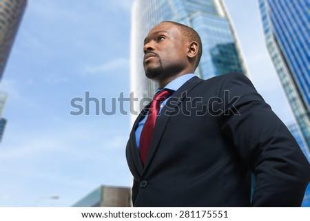 Portrait of an handsome confident businessman - stock photo
