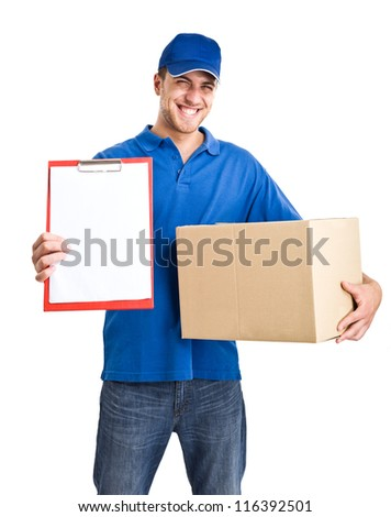 Portrait of an handsome deliverer holding a box. Isolated on white - stock photo