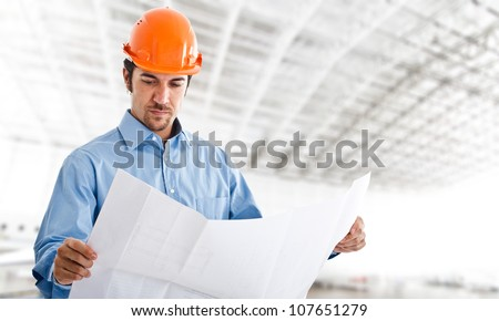 Portrait of an handsome engineer at work - stock photo