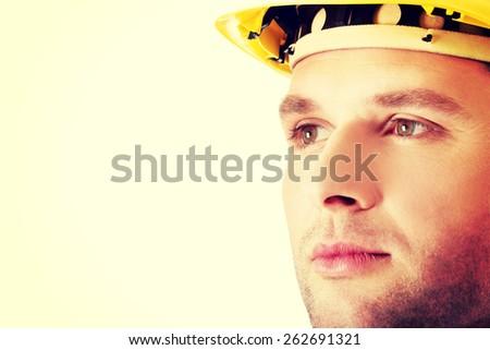 Portrait of an handsome engineer in helmet - stock photo