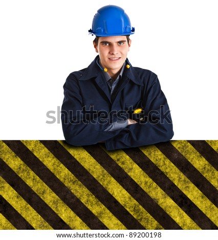 Portrait of an handsome engineer leaning on a sign - stock photo