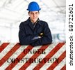 "Portrait of an handsome engineer leaning on a ""Under construction"" sign - stock photo"