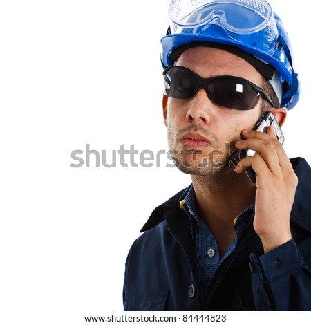 Portrait of an handsome engineer talking on the cell phone. Isolated on white - stock photo