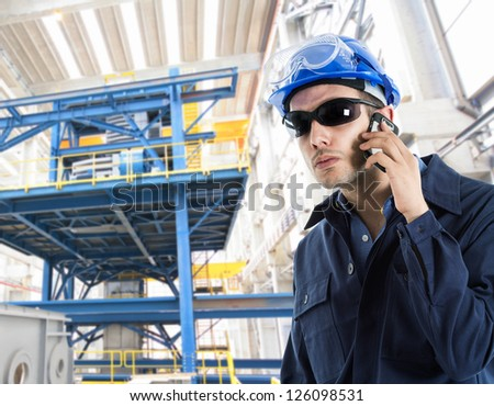 Portrait of an handsome engineer talking on the phone - stock photo