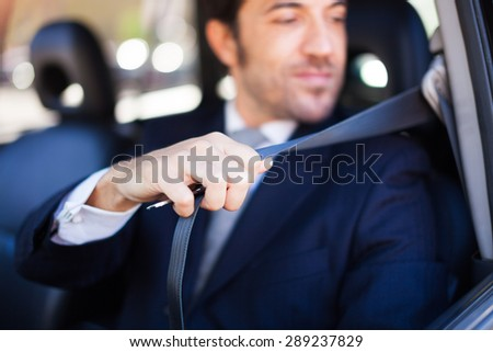 Portrait of an handsome guy using the safety belt - stock photo