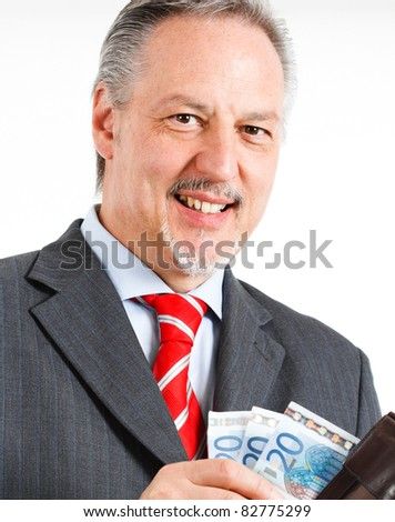 Portrait of an handsome positive businessman counting money