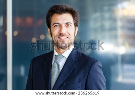 Portrait of an handsome smiling business man - stock photo