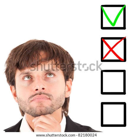 Portrait of an handsome thoughtful man choosing between four options - stock photo