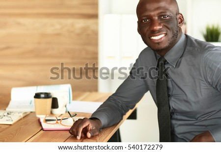 Portrait of an handsome young black businessman