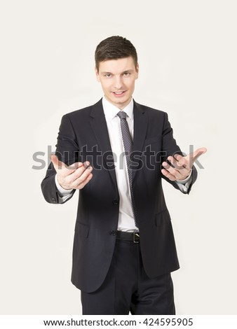 Portrait of an handsome young businessman on the gray background.
