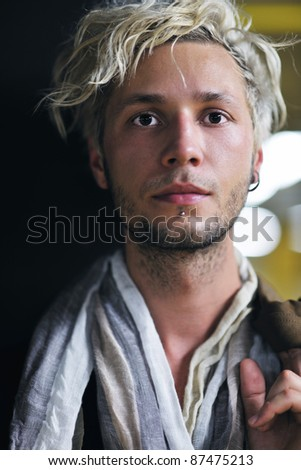 Portrait of an handsome young  man  with urban background and fashion clothes style - stock photo