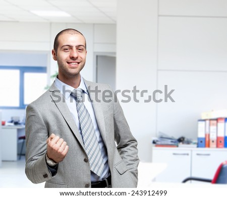 Portrait of an happy businessman in his office - stock photo