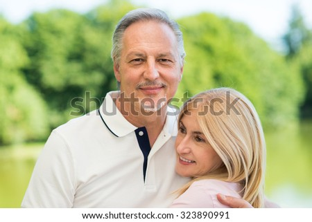 Portrait of an happy mature couple in a park