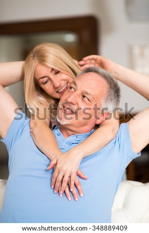 Portrait of an happy mature couple. Shallow depth of field, focus on the man