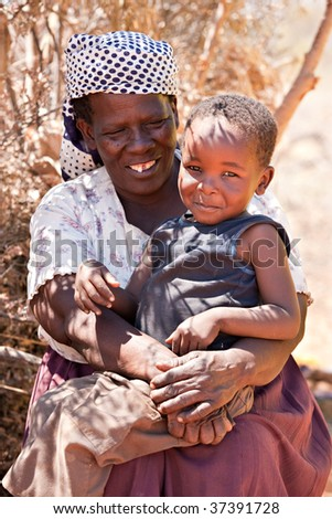 portrait  of an happy old African woman and child, Botswana, - stock photo