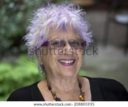 portrait of an happy old woman - stock photo