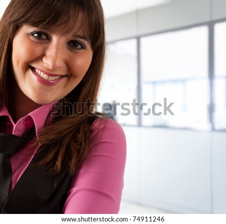 Portrait of an happy woman in an office environment. - stock photo