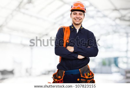 Portrait of an happy worker - stock photo