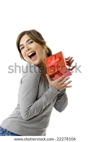 Portrait of an happy young woman holding a gift - isolated on white background - stock photo