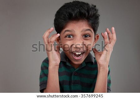 Portrait of an Indian boy cheering up - stock photo