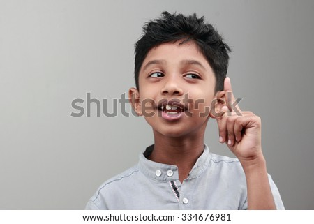 Portrait of an Indian boy with an expression when he gets an idea or solution - stock photo