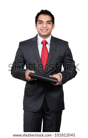 portrait of an Indian Busineeman holding a book