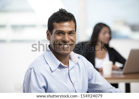 Portrait of an Indian Business man standing in an office