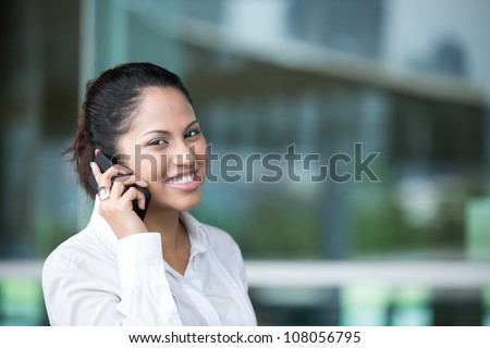 Portrait of an Indian business woman using cell phone.